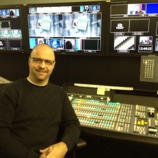 Technical Director Serge Geralds sitting in front of his switcher board during a break of live coverage of SuperStorm Sandy